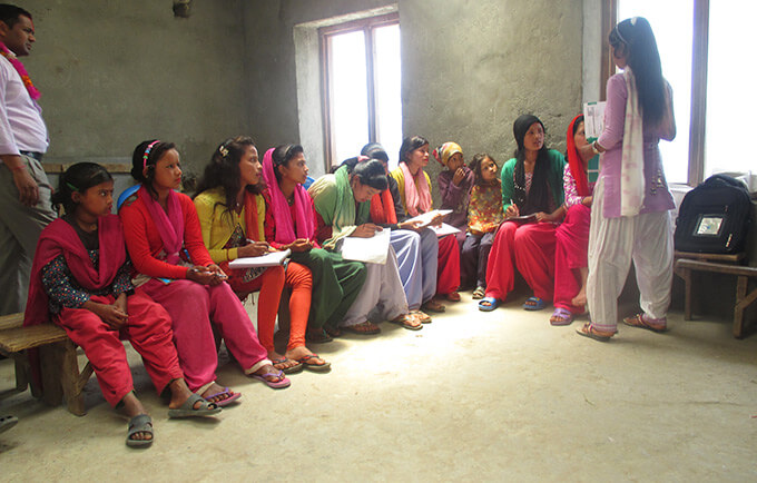 Girls learning about menstrual health.