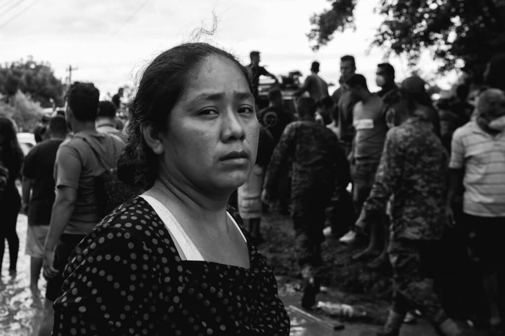 A woman in Honduras after Hurricane Eta, one of the worst storms to hit the region.